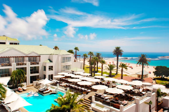 Unwind on the luxurious pool deck of The Bay Hotel in Camps Bay.
