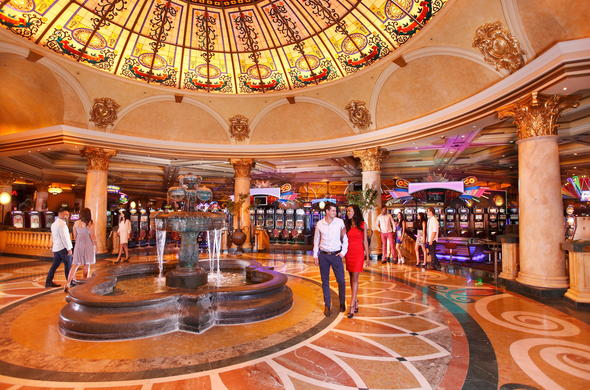 Visit the Emperors Place Casino and try your luck on the slots.