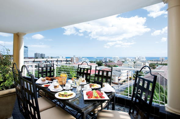 Enjoy delicious meals and scenic views from the deck at Romney Park All Suite Hotel & Spa.