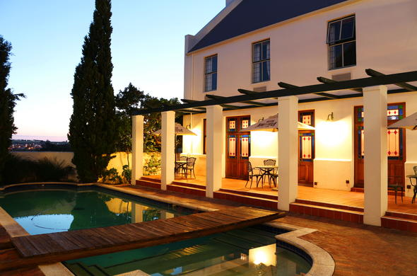Stellenbosch Lodge Country Hotel view of the pool at night.