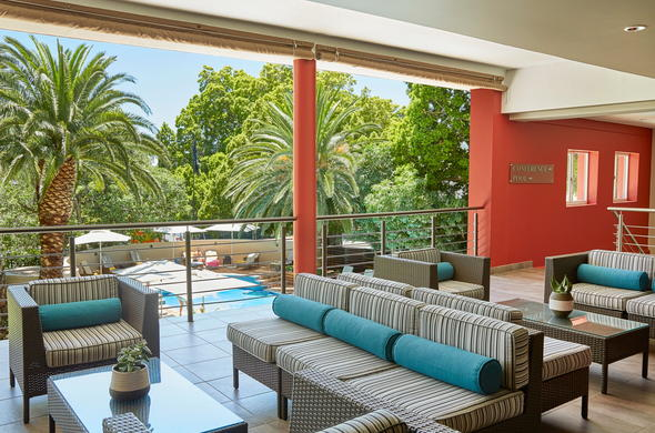 Unwind on the terrace of Sun Square Cape Town Hotel.